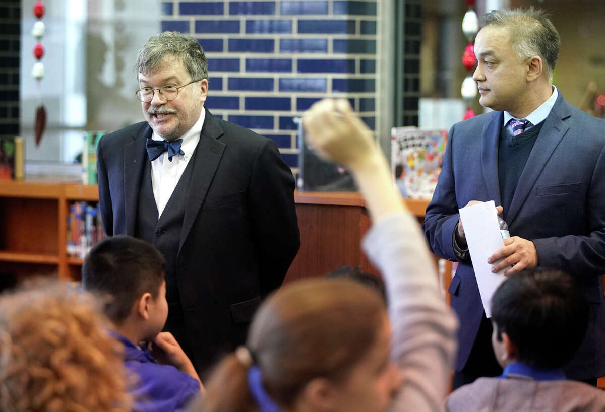 Dr. Peter Hotez, dean of the National School of Tropical Medicine at Baylor College of Medicine, left, and Dr. Umair A. Shah, excutive director of Harris County Public Health, right, talk to a group of students after a press conference at Pin Oak Middle School, 4601 Glenmont St., Wednesday, Feb. 13, 2019, in Houston. Advocates and public health experts gathered to urge lawmakers to support strong vaccine legislation. A group of 7th and 8th grade journalism students from the school attended the press conference.