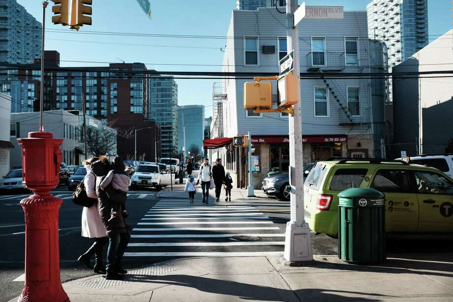 People walk through the Long Island City neighborhood on Feb. 9, 2019, in Queens, N.Y. Amazon announced on Thursday, Feb. 14 that it was abandoning its plans for a new headquarters in Long Island City. Photo: Spencer Platt / Getty Images / 2019 Getty Images