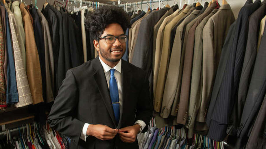 Freshman Marcus Kwasa tries on a suit in SIUE's Cougar Career Closet. Photo: For The Intelligencer