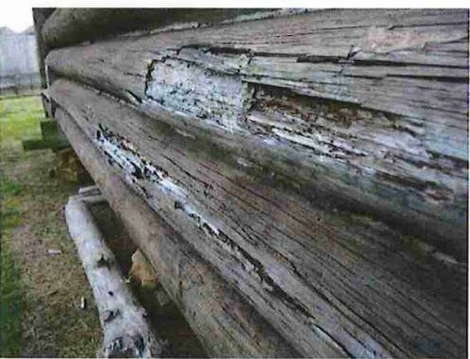 A close up look at the rot on six logs identified by the American Log Restoration, Inc. in North Carolina as in need of repairs replacement at Crane Cabin at Fernland Historical Park in Montgomery. Photo: Submitted Photo / Submitted Photo