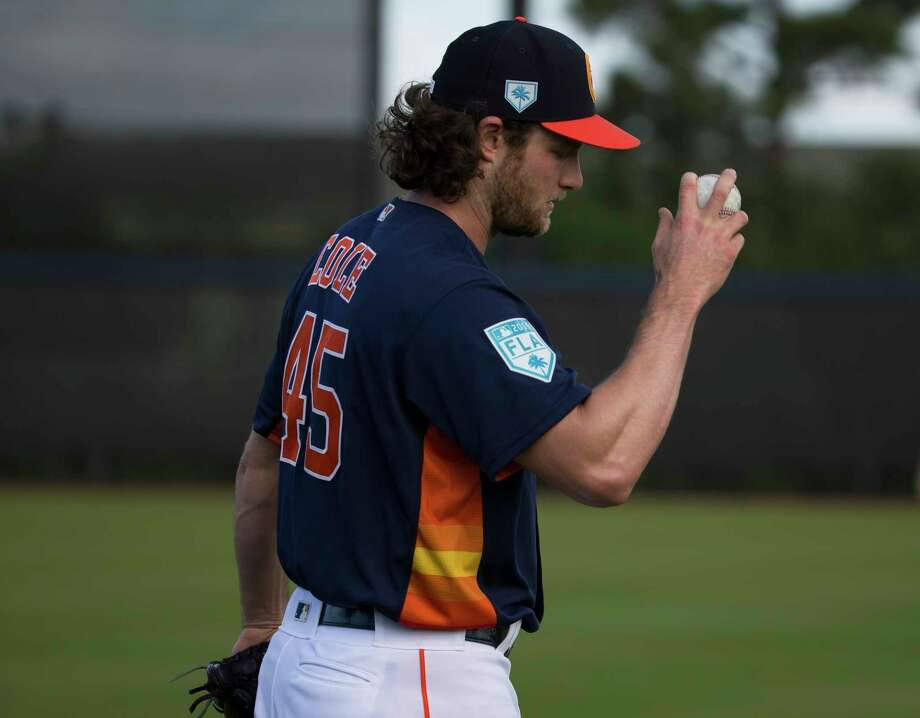 Houston Astros right handed pitchers Gerrit Cole (45) throws warm-up pitches at Fitteam Ballpark of The Palm Beaches on Day 1 of spring training on Thursday, Feb. 14, 2019, in West Palm Beach. Photo: Yi-Chin Lee, Houston Chronicle / © 2019 Houston Chronicle