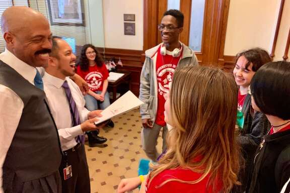 Students from the Mental Health Ambassadors group at Memorial High School met with lawmakers at the Texas state capital in Austin on Wednesday, Feb. 6, to push for better mental health services in schools. Here, State Senator Borris Miles (left) speaks with students Jasmine (sitting in the back), Reddrick, Marissa, Allison and Sara.