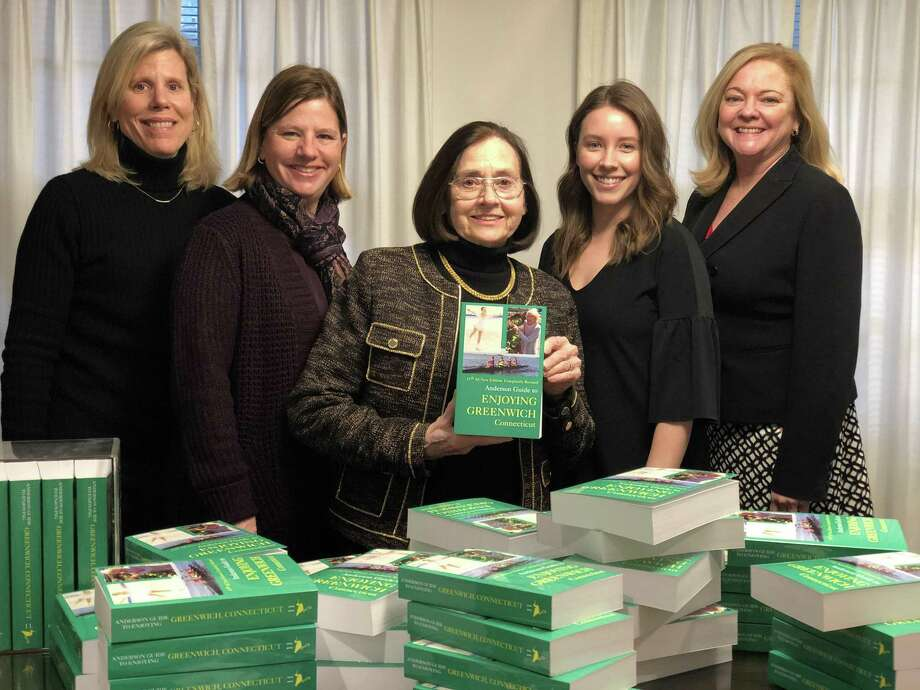 """Local Realtor and town resident Carolyn Anderson, at center, displays copies of the 11th edition of """"The Anderson Guide to Enjoying Greenwich."""" She is flanked by her team at Anderson Associates, from left, Monica Collins, Cecilia Fernandez, Katie Bookser and Amy Zeeve. Photo: Contributed /"""