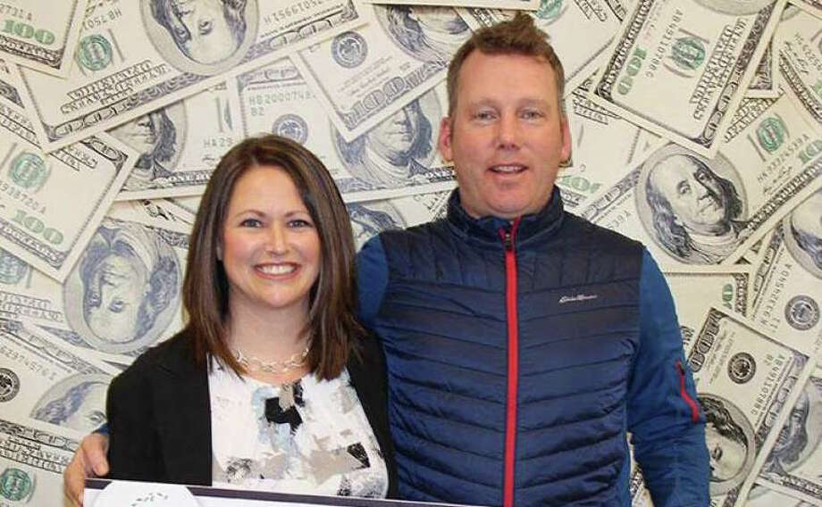 "Kristopher and Dawn Brooks of North Haven hold a symbolic check for $250,000 at CT Lottery headquarters in Rocky Hill. The winning Powerball numbers drawn on Feb. 6, 2019 6 were 5 - 13 - 28 - 38 - 63 and Powerball 21. The Power Play number was 5. Kristopher's Powerball ""Quick Pick"" ticket matched four of the first five numbers drawn, plus the Powerball. Because he also purchased the Power Play® option, his $50,000 prize was multiplied to $250,000. Photo: CT Lottery Photo"