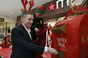 Holyoke Mayor Alex Morse mails a letter to Santa as Holyoke Police Captain Matthew Moriarty stands by to mail his letter during the kickoff of Macy's annual Believe Campaign at Macy's Holyoke Mall on Friday, Nov. 2, 2018 in Holyoke, Mass. Macy's is celebrating the 11th annual Believe Campaign. For each letter addressed to Santa and dropped off at Macy's Believe mailbox, Macy's will donate $1 up to $1 million to Make-A-Wish.