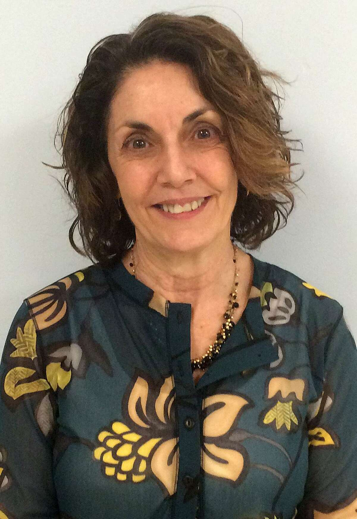 Mary Lou DiBella, the prinicipal of an elementary school in Newtonville, Mass., has been hired as the new principal of Kings Highway Elementary School as of this summer.