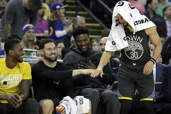 ae47cf9f7b5b 1of3Klay Thompson (11) and Stephen Curry (30) high five after Jonas Jerebko  (21) hit a three pointer in the first half as the Golden State Warriors  played ...