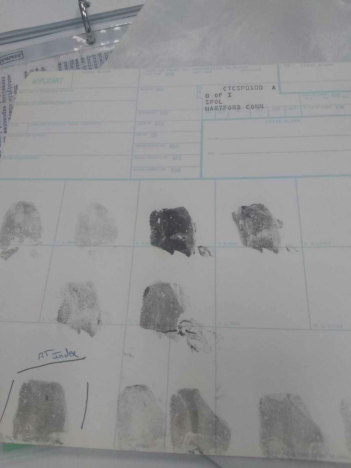 Norwalk Police Lt. Art Weisgerber, head of the crime scene unit, shows off equipment and fingerprints, Feb. 14, 2019.
