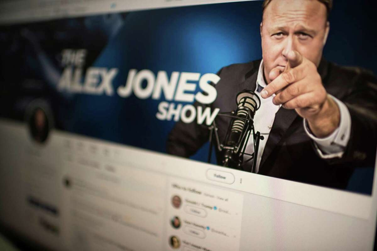 Picture showing a computer screen displaying the Twitter account of Far-right conspiracy theorist Alex Jones taken on August 15, 2018 in Washngton DC. - Far-right conspiracy theorist Alex Jones said his Twitter account had been suspended for a week, the latest online platform to take action against the activist. Twitter suspended the personal account of Jones, who operates the Infowars website that has disputed the veracity of the September 11 attacks, the Sandy Hook school massacre and other events. (Photo by Eric BARADAT / AFP)ERIC BARADAT/AFP/Getty Images