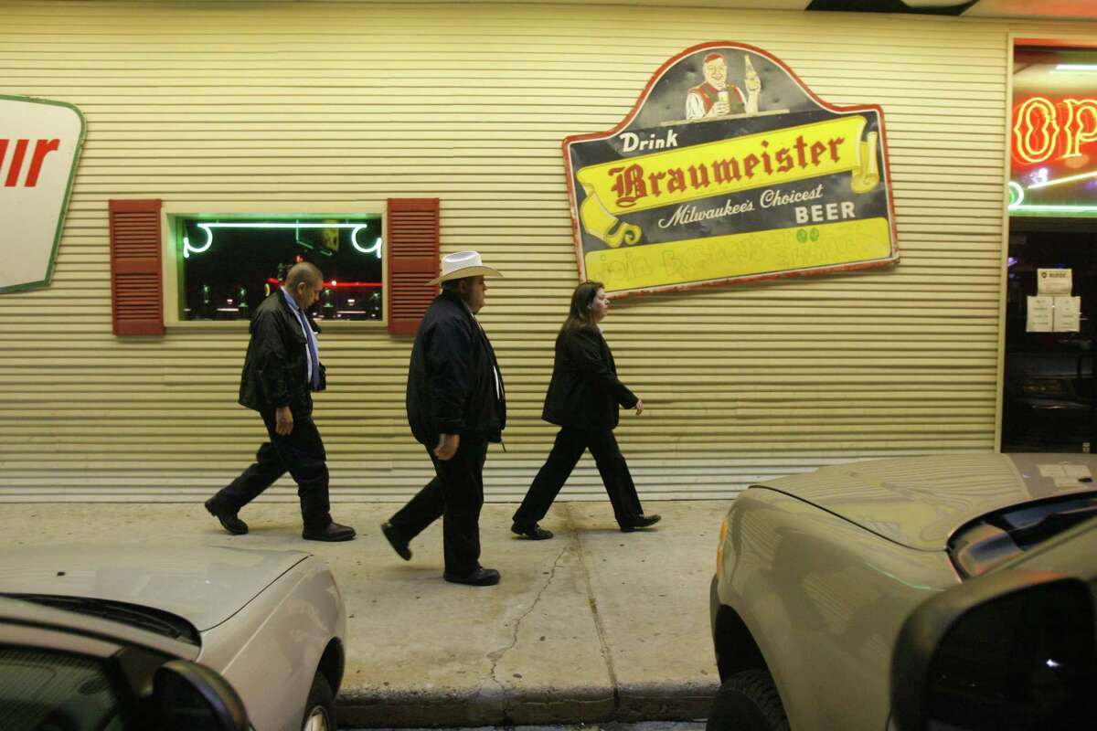 4/1/06-Texas Alcoholic Beverage Commission agents (left to right)Sergio Salvidar, Larry Whitbey, and Kelly Kersh prepare to check out Barney's on FM 1960 Saturday night, 4/1/06. Photo by Steve Campbell, Chronicle Staff