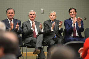 From left, John Sharp, chancellor of the Texas A&M university system, Tim Leach, Chairman and CEO of Concho Resources, State Rep. Tom Craddick, and State Rep. Brooks Landgraf, applaud during an announcement about the Texas A&M-Concho Engineering Academy, Feb. 14, 2019, in the Carrasco Room at Midland College. The program offers students the opportunity to pursue a degree in engineering while being co-enrolled at Midland College and Texas A&M University. James Durbin/Reporter-Telegram