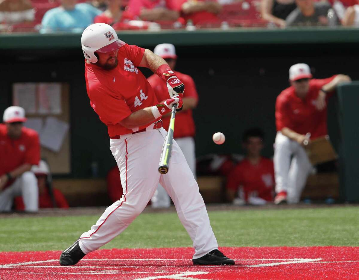 Houston Cougars first baseman Joe Davis (44) hits a home run.