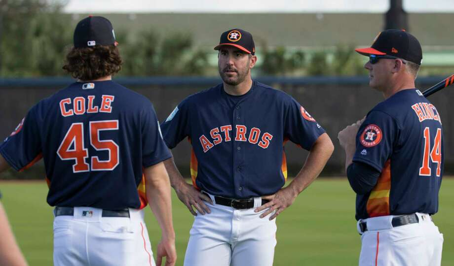 PHOTOS: Houston Astros 2019 fan giveaways   Houston Astros pitchers Gerrit Cole and Justin Verlander talk to manager AJ Hinch during warm up at Fitteam Ballpark of The Palm Beaches on Day 1 of spring training on Thursday, Feb. 14, 2019, in West Palm Beach.   >>>See the remaining Astros fan giveaways at Minute Maid Park this season ...  Photo: Yi-Chin Lee, Houston Chronicle / © 2019 Houston Chronicle