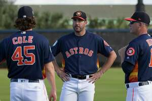 Houston Astros pitchers Gerrit Cole and Justin Verlander talk to manager AJ Hinch during warm up at Fitteam Ballpark of The Palm Beaches on Day 1 of spring training on Thursday, Feb. 14, 2019, in West Palm Beach.