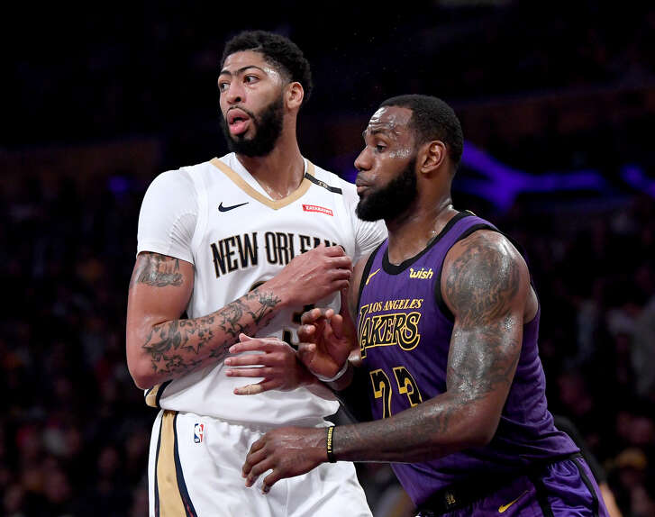 Anthony Davis (left) and LeBron James didn't come teammates at last week's NBA trade deadline, but they'll be on the same side at the All-Star Game on Sunday in Charlotte.