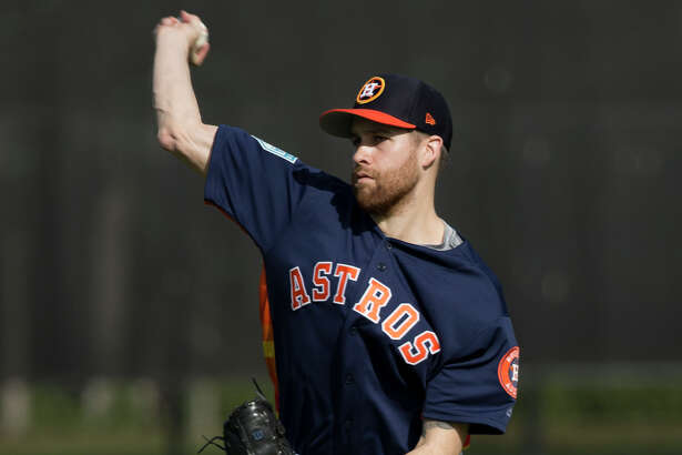 Houston Astros right handed pitcher Collin McHugh (31) throws warm-up pitches at Fitteam Ballpark of The Palm Beaches on Day 1 of spring training on Thursday, Feb. 14, 2019, in West Palm Beach.