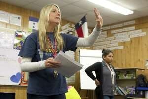 Language acquisition teacher Adriana Guarinos tells students they have five minutes remaing in class during a Newcomer Program class at Hauke Academic Alternative High School, Wednesday, Feb. 13, 2019, in Conroe. The program, a collaboration between Conroe ISD and the Mexican Consulate's Plazas Comunitarias program, teaches recently immigrated students an elementary and middle school education in one year.