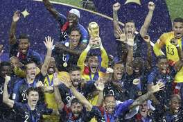 French players celebrate with the trophy at the end of the final match between France and Croatia at the 2018 soccer World Cup in the Luzhniki Stadium in Moscow, Russia, Sunday, July 15, 2018. (AP Photo/Thanassis Stavrakis)