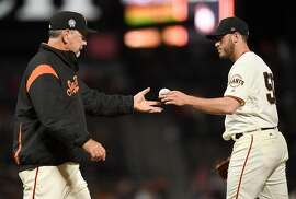 SAN FRANCISCO, CA - SEPTEMBER 11:  Manager Bruce Bochy #15 of the San Francisco Giants takes the ball from Ty Blach taking Blach out of the game against the Atlanta Braves in the top of the eighth inning at AT&T Park on September 11, 2018 in San Francisco, California.  (Photo by Thearon W. Henderson/Getty Images)