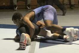 Middletown's Kalil Shabazz wrestles with Carson Sassu of Bristol Eastern in the second period before winning by pin in the third.