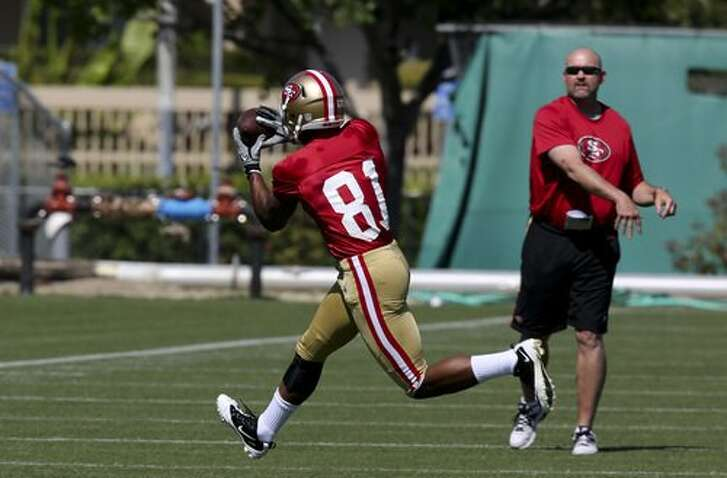 Wide Receiver Chris Owusu, 81, runs passing drills with Wide Receiver Coach John Morton during the 49ers rookie minicamp at the 49ers practice field on Friday, May 11, 2012 in Santa Clara, Calif.