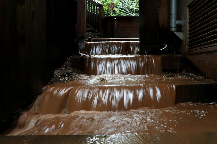 Muddy water flows down the stairs of a home near where a mudslide swept away a home during a rain storm on February 14, 2019 in Sausalito, California. 50 homes in the town of Sausalito were evacuated after a mudslide struck homes and sent at least one sliding 75 yards down a hill. No injuries were reported. (Photo by Justin Sullivan/Getty Images) Photo: Justin Sullivan/Getty Images