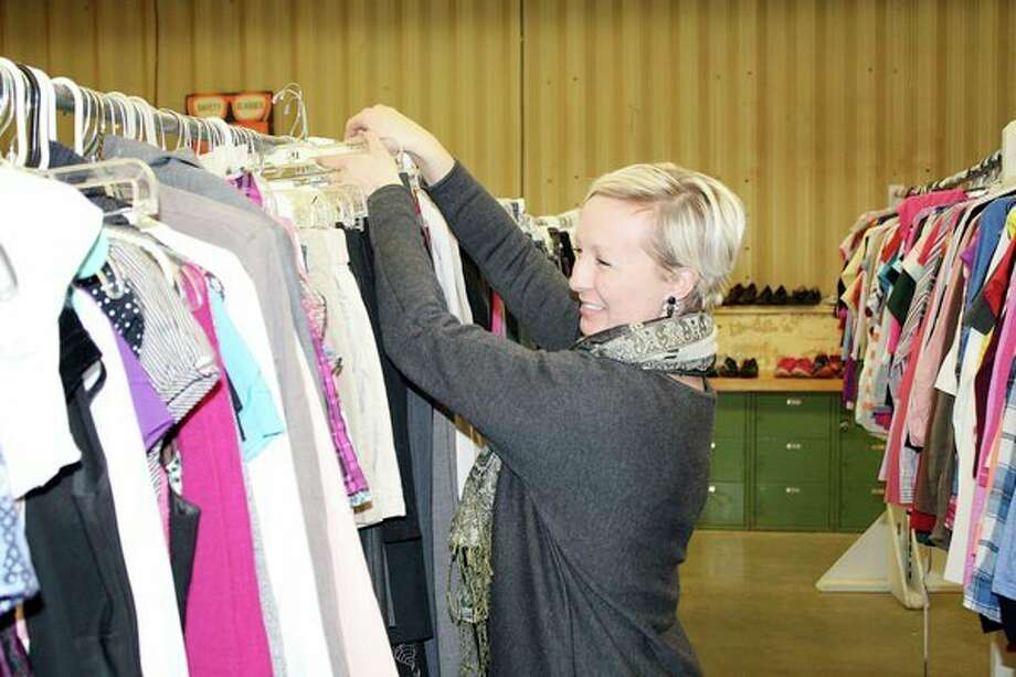 Lindsey Roberts, director of the Kids Kloset, sorts through some new items of clothing at the Harbor Beach-based business. The Kids Kloset recently reopened after being closed for six months. (Rich Harp/For the Tribune)