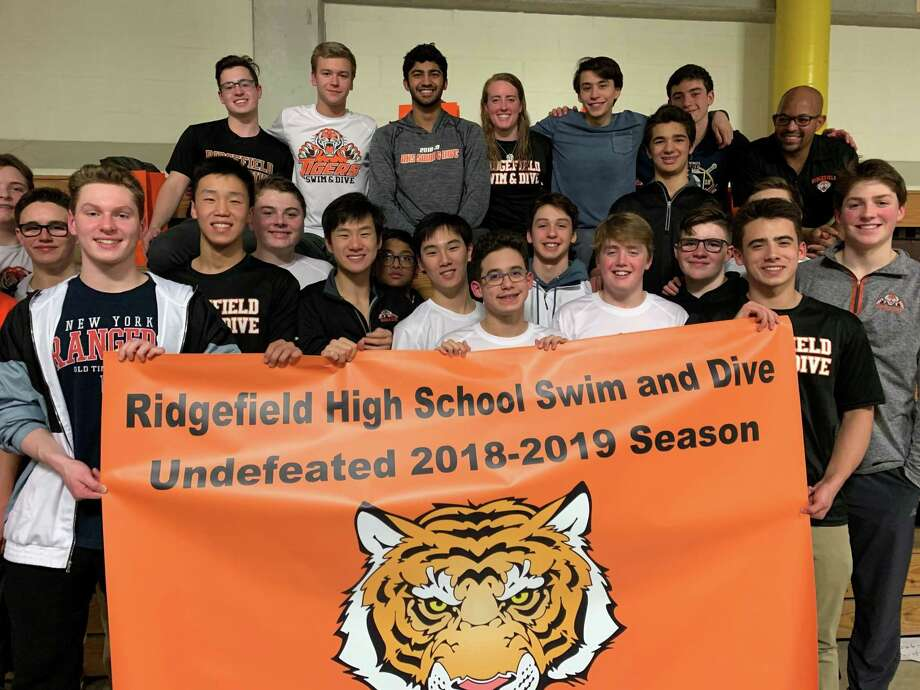 The Ridgefield High School boys swimming team gathered following their win over Danbury on Wednesday — a victory that capped a 10-0 regular season. Photo: Contributed Photo / Greenwich Time Contributed