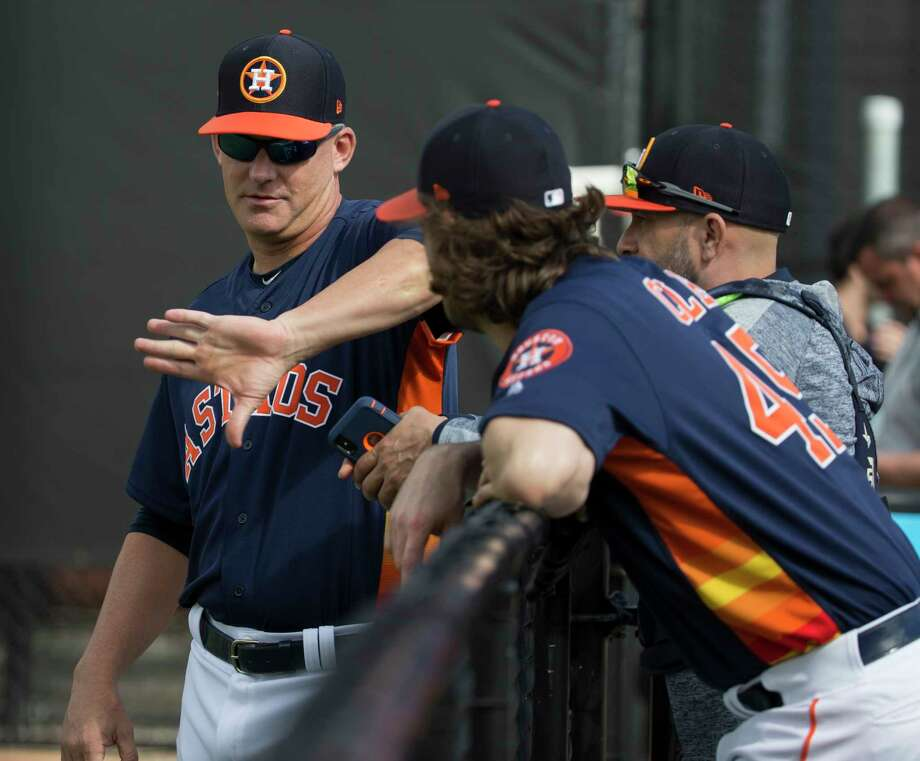 PHOTOS: Astros salaries for 2019 Houston Astros manager AJ Hinch talks to pitcher Gerrit Cole and bullpen catcher Javier Bracamonte at Fitteam Ballpark of The Palm Beaches on Day 1 of spring training on Thursday, Feb. 14, 2019, in West Palm Beach. >>>Browse through the photos for a look at contract details for each Astros player for 2019 ... Photo: Yi-Chin Lee, Houston Chronicle / © 2019 Houston Chronicle