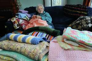 Victoria Butler, in her Norwalk home Thursday, spends her days crocheting and donating the afghans to local organizations, including STAR Inc. and St. Matthew's Church.