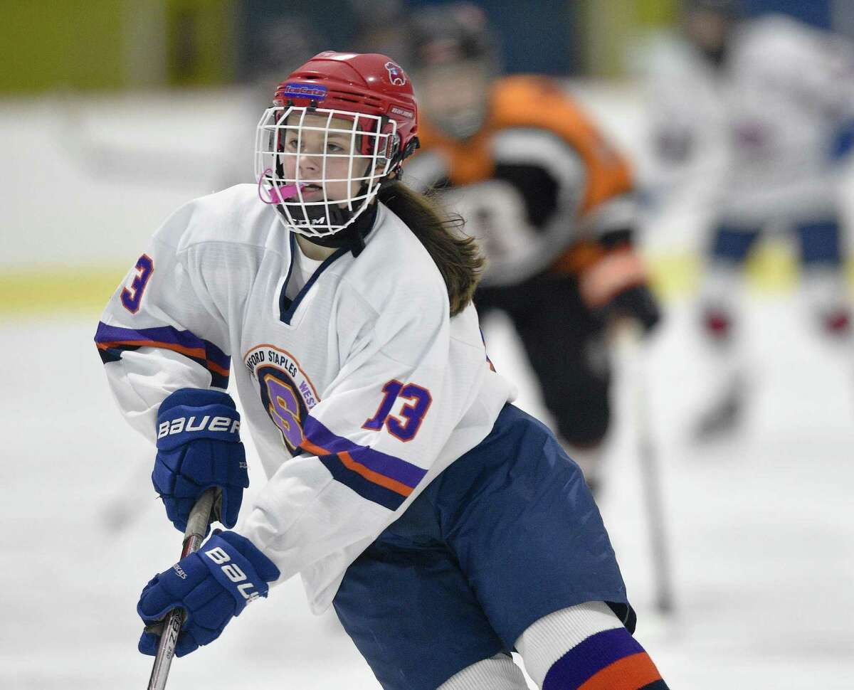 Stamford-Westhill-Staples Co-op freshman center Meadow Gilchrist works the ice on Jan. 26 ,against Ridgefield-Danbury at Terry Conners Ice Rink in Stamford.