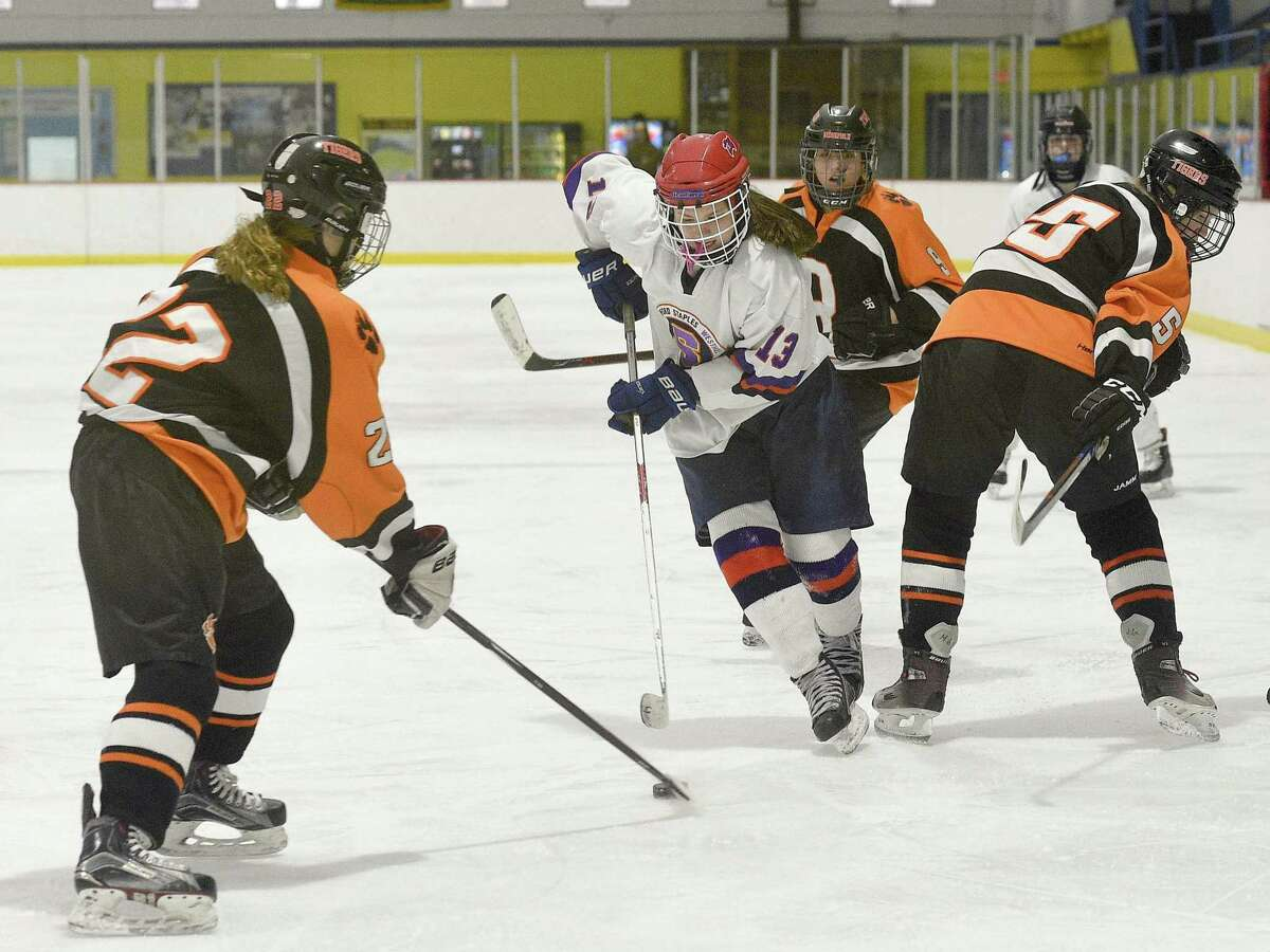 Stamford-Westhill-Staples Co-op freshman center Meadow Gilchrist works the ice on Saturday, Jan. 26, 2019 during SWS's match up against Ridgefield-Danbury at Conners Ice Rink in Stamford, Connecticut.