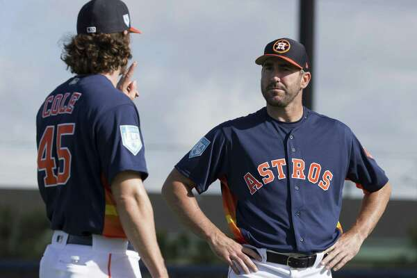 Astros pitchers Gerrit Cole, left, and Justin Verlander chat during Thursday's first workout for pitchers and catchers in West Palm Beach, Fla.