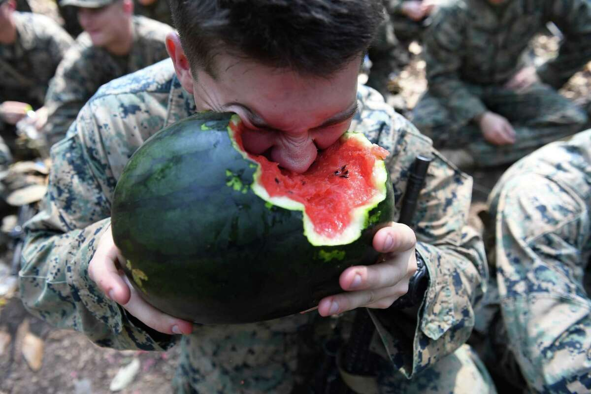 A US Marine soldier eats a watermelon during a jungle survival training with Thai soldiers in the joint 'Cobra Gold' military exercise in Chantaburi province on February 14, 2019. - The US and Thailand hold on February 14, the annual joint 'Cobra Gold', the largest US-led military exercises in Asia involving gruelling drills in the Thai jungle, war games, humanitarian assistance and disaster relief exercise. (Photo by Lillian SUWANRUMPHA / AFP)LILLIAN SUWANRUMPHA/AFP/Getty Images
