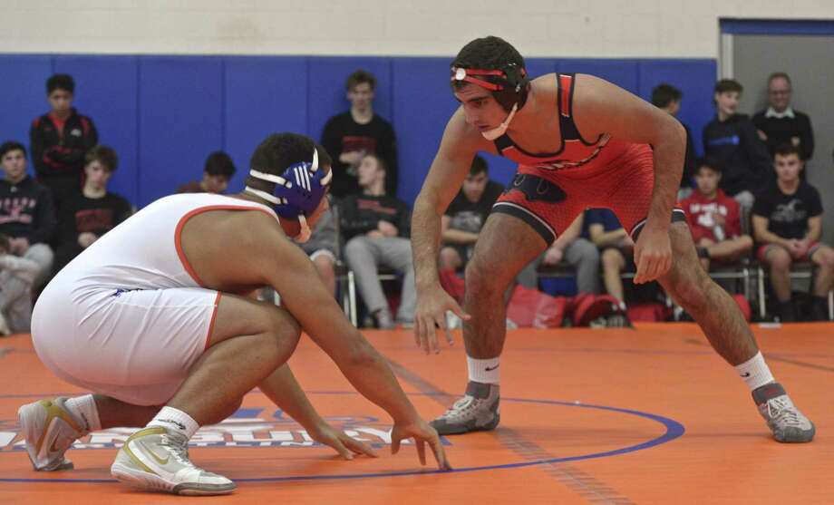 Warde's Joe Gjinaj (red) and Danbury's Montez Osbey wrestle in the 195-pound weight class on Dec. 19, 2018. Photo: H John Voorhees III / Hearst Connecticut Media / The News-Times