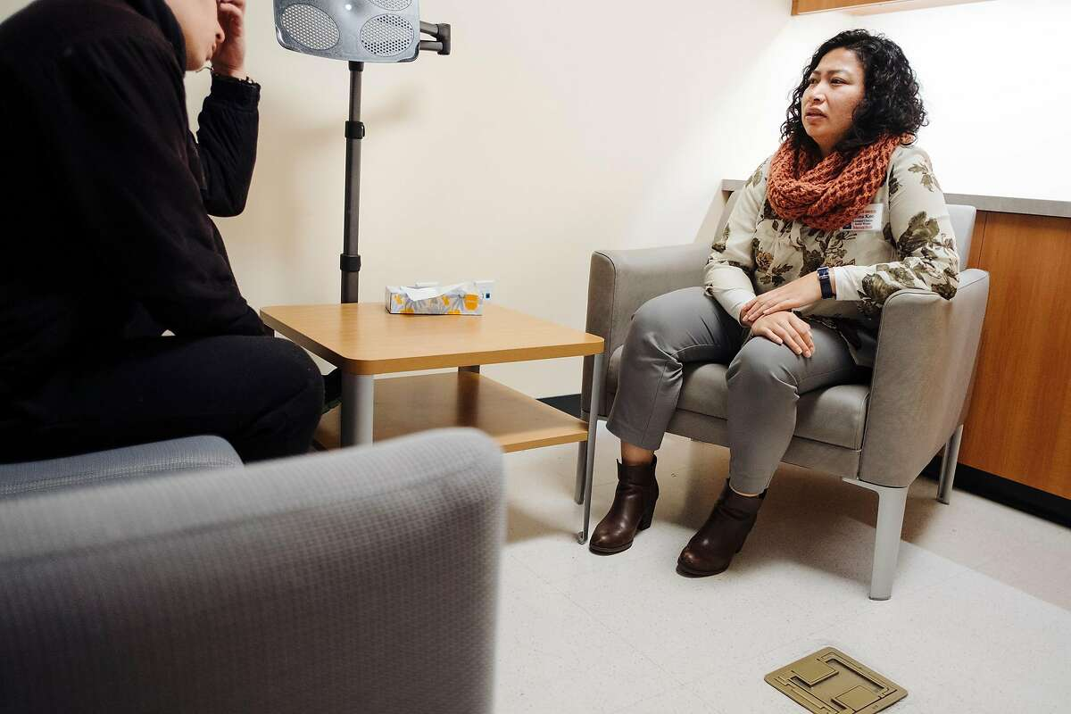 Licensed Clinical Social Worker Zona Keo works with a client at Asian Health Services' Harry & Jeanette Weinberg Dental & Wellness Clinic in Oakland, Calif., on Wednesday, February 13, 2019. Asian Health Services has found success employing social workers to talk with dental patients that may be dealing with mental health issues that come to light when the patients fill out initial patient questionnaires before their dental visits.