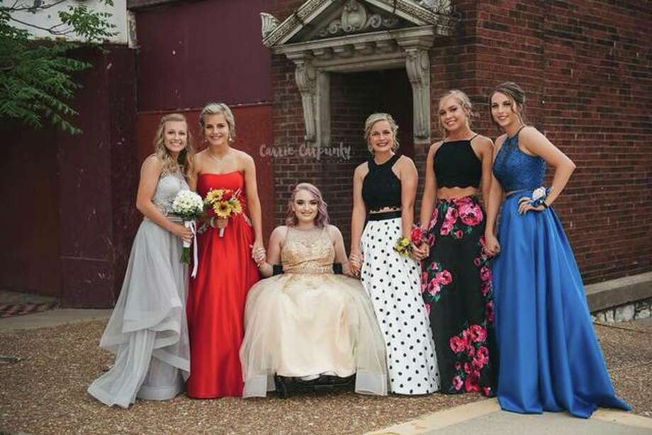 Alton, Illinois' Katelyn Carpunky, 18, sitting, bonds with friends for a formal affair. Carpunky caught the attention of well-known cosmetics brands and influential high-profile makeup artists when she took to Instagram to blog and post videos demonstrating her makeup artistry and application techniques via Glam by Katelyn (@glambykk). She often does the makeup of her friends and their family members. Photo: For The Edge