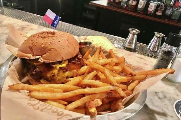 Venison chili cheeseburger with fries at Armadillo Palace