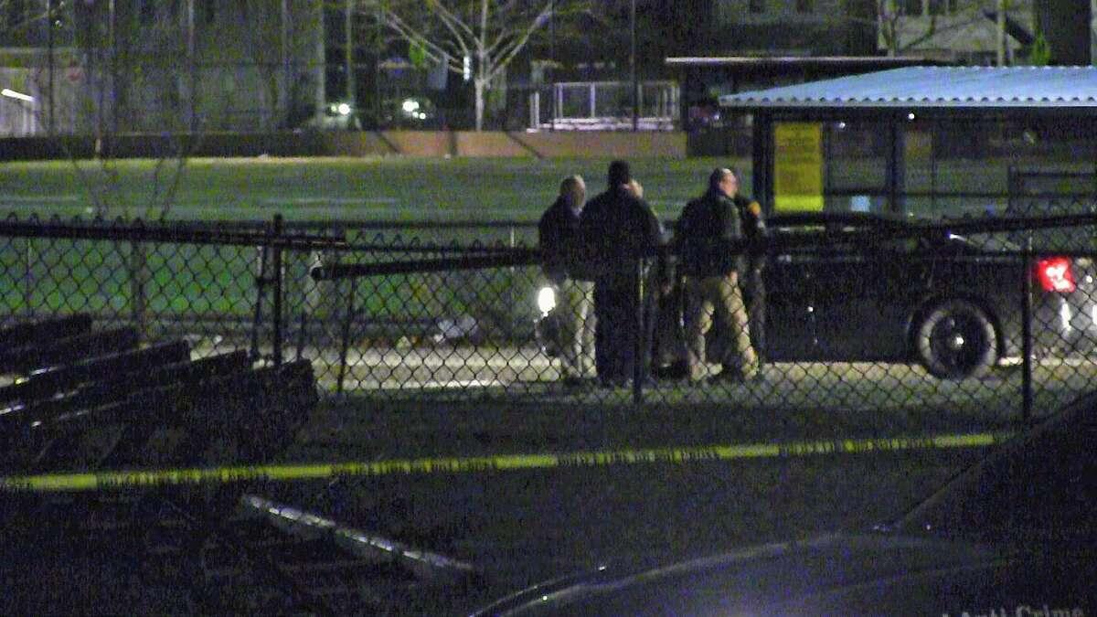 Police investigate a homicide in Bridgeport, Conn., on Monday, Feb. 11, 2019.