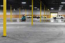 A worker drives a machine that cleans the floor at the former Groves' Kmart that is being converted into a climate controlled storage facility. Photo taken Tuesday, 2/12/19