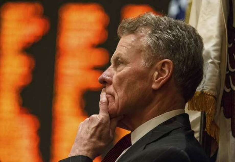 In this Aug. 28, 2017 file photo, Illinois Speaker of the House Michael Madigan, D-Chicago, looks out over the floor the Illinois House as they get set to vote during a special session at the Illinois State Capitol in Springfield, Ill. Photo: Justin L. Fowler | The State Journal-Register Via AP