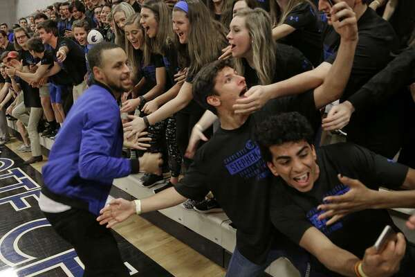 2of13Golden State Warrior s Stephen Curry greets students after a halftime  ceremony at his former high school in Charlotte c1f1a3c82
