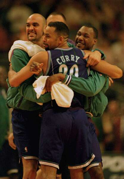 8 Apr 1996  Charlotte Hornets center Matt Geiger (left) and guard Darrin  Hancock (right) hug guard Dell Curry following Charlotte Hornets win over  the ... 6067dbb24