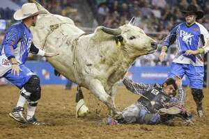 Bull rider Elliot Jacoby is flung off the back of Heisenberg during Round 1 of Super Series I of the 2018 Houston Livestock Show and Rodeo.
