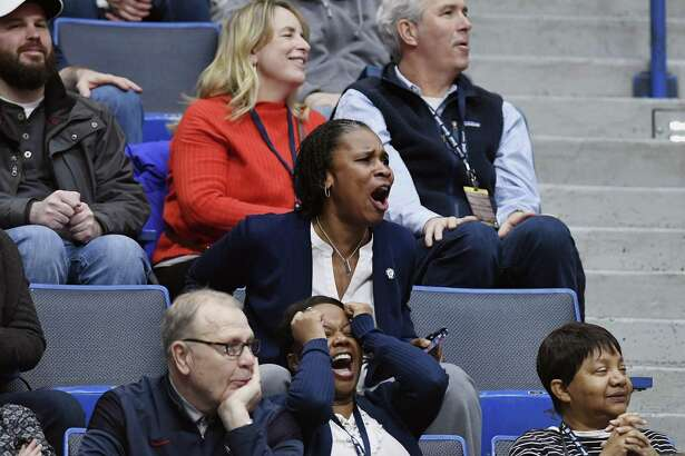 Jamelle Elliott, UConn's Associate Athletic Director for the National C Club, watches from the stands as the Huskies played UCF on Jan. 27 at the XL Center in Hartford. Elliott, a former UConn player and coach, returned to the the school last year.