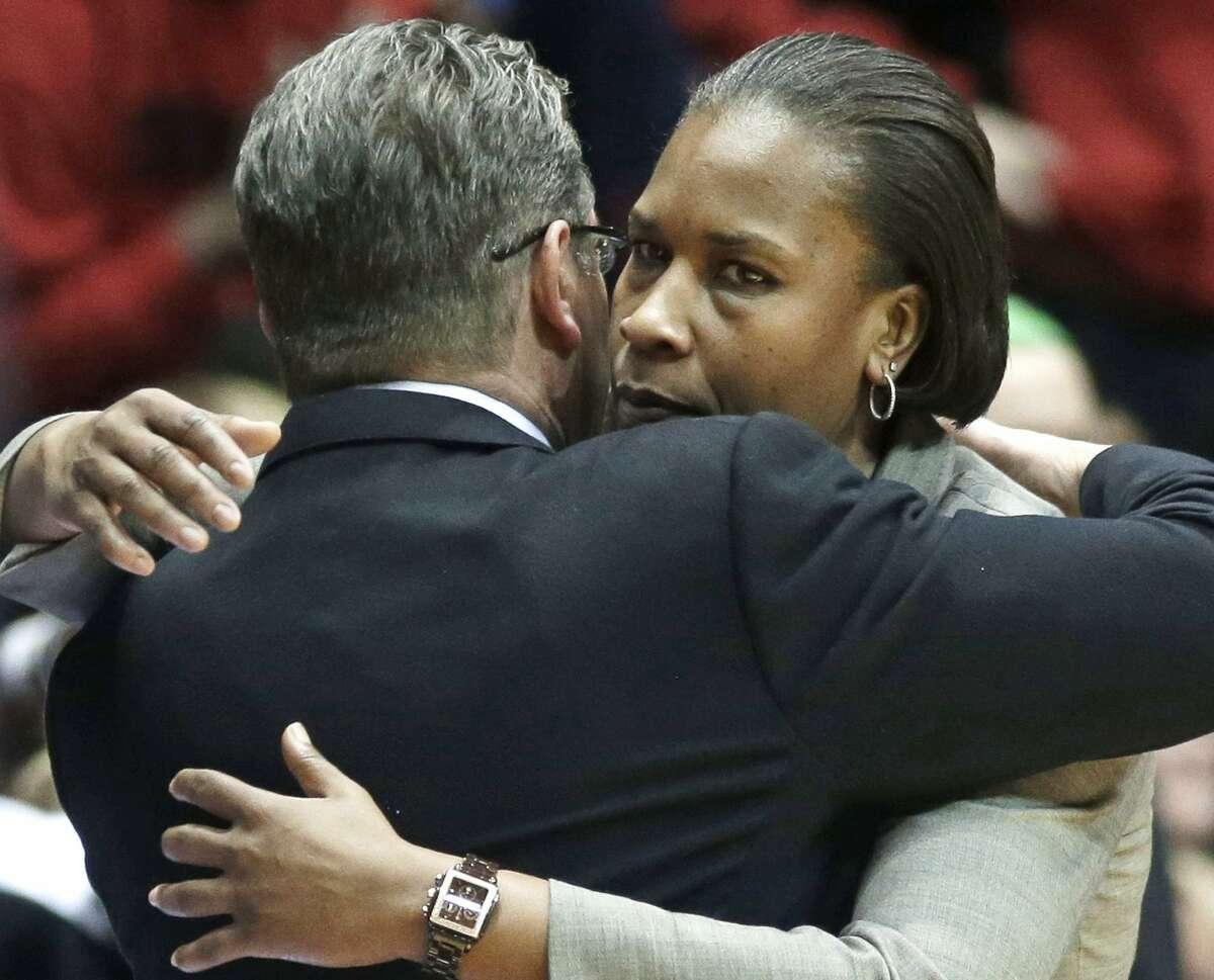 Cincinnati coach Jamelle Elliott, right, hugs UConn coach Geno Auriemma after UConn's 86-29 win on Feb. 1, 2014 in Cincinnati.