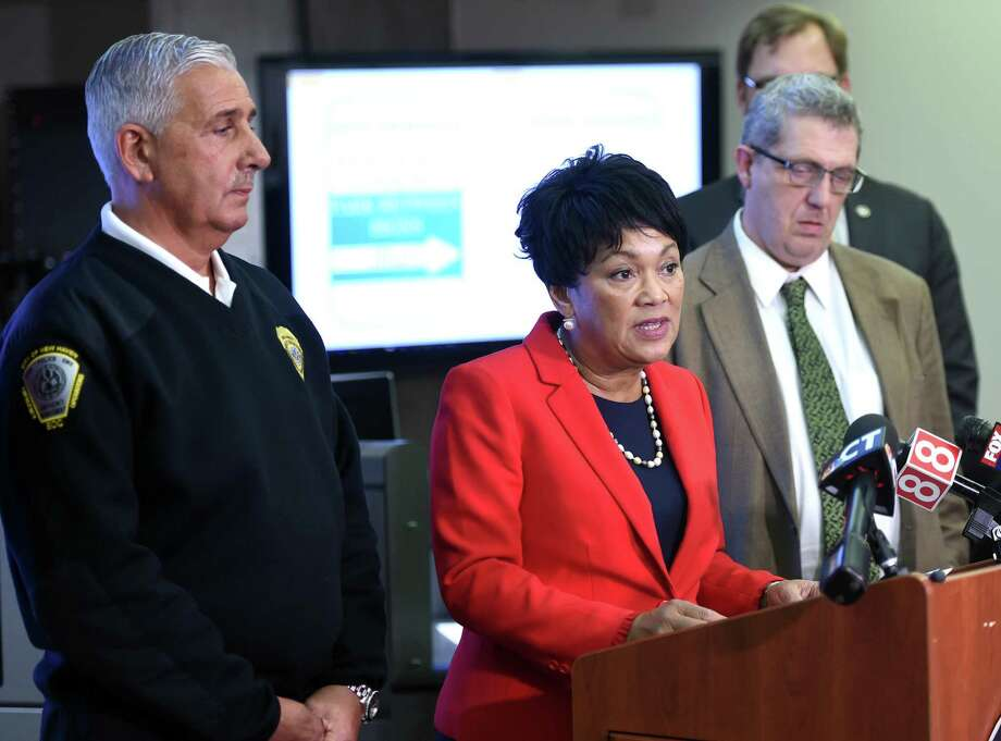 New Haven Mayor Toni Harp (center) talks about the city's revised winter weather response including street clearing and snow removal operations at the Emergency Operations Center in New Haven in December 2018. At left is Rick Fontana, director of Emergency Operations. Photo: Arnold Gold / Hearst Connecticut Media / New Haven Register