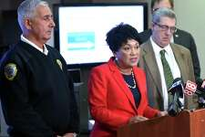 New Haven Mayor Toni Harp (center) talks about the city's revised winter weather response including street clearing and snow removal operations at the Emergency Operations Center in New Haven on December 5, 2018. At left is Rick Fontana, director of Emergency Operations.