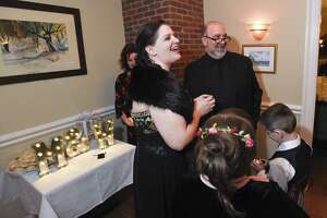 Stamford native Michele Kulis and Walter Junker react to joyful cheers from family and friends after being married by Justice of the Peace Regan Allen in a small Valentine's Day ceremony at Pellici's Resturante on Feb. 14, 2019 in Stamford, Connecticut.