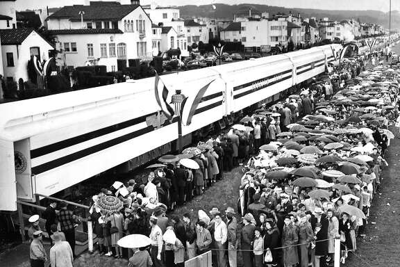 The Freedom Train would tour three hundred cities in the United States, providing people with an up close look at some of the most historic documents in history. Crowds wait in the rain to enter the train March 15, 1948  photo ran 3/16/1948, p. 8